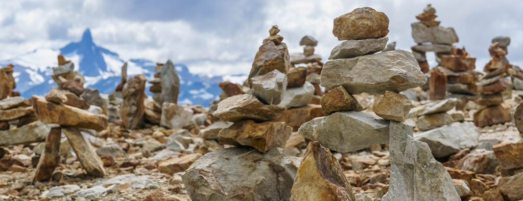 Inukshuks built by hikers on top of Cougar Mountain, a summer activity destination.